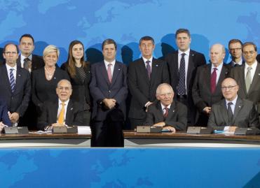 José Ángel Gurría, secrétaire général de l'OCDE, Wolfgang Schäuble et Michel Sapin à Berlin © Axel Schmidt/OCDE